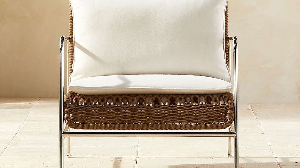 Corrina Faux Rattan Lounge Chair with Ivory Sunbrella ® Cushions - Image 1 of 7