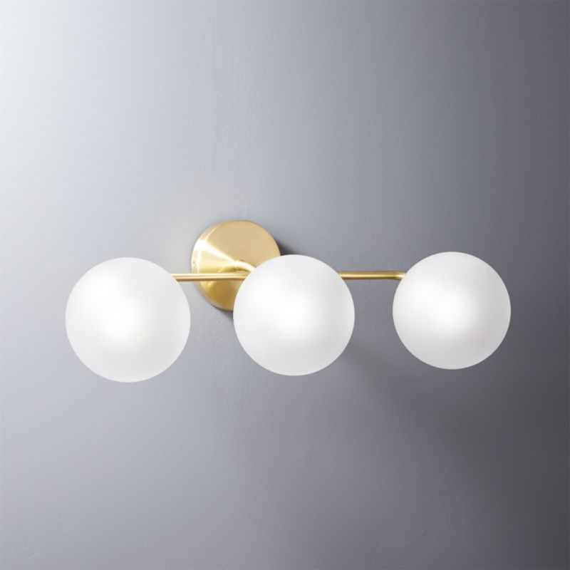 https://cb2.scene7.com/is/image/CB2/VegaBath3BulbBrassSconceSHF16/$web_setitem326$/160718115024/vega-bath-3-bulb-brass-wall-sconce.jpg
