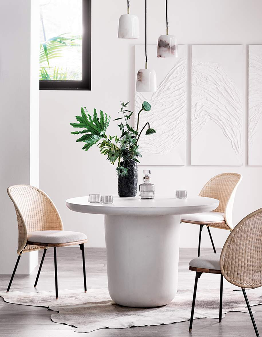 modern dining room with white round dining table