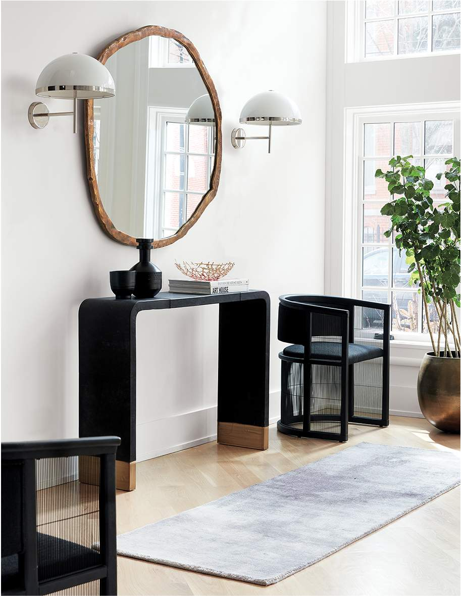 modern entryway with leather console table
